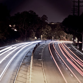 Streaks by Johnny Hirth - City,  Street & Park  Street Scenes ( water, ocean, seascape, beach, landscape, lifeguard, traffic, nature, cars, dramatic, moody, night, long exposure, bridge, freeway )