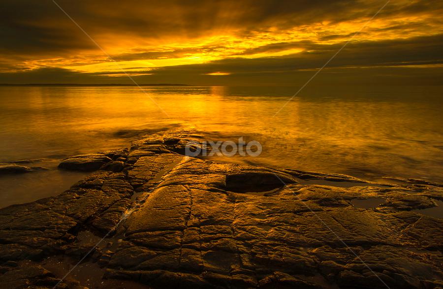 Golden rock by Peter Samuelsson - Landscapes Waterscapes