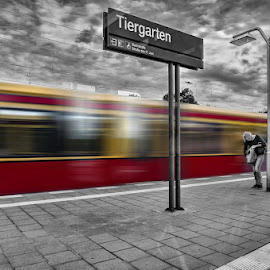 Passing by Lior Faust - City,  Street & Park  Street Scenes ( clouds, signs, black and white, street, reflections, transportation, street photography, blackandwhite, sky, color, woman, train, germany, berlin, street scenes )