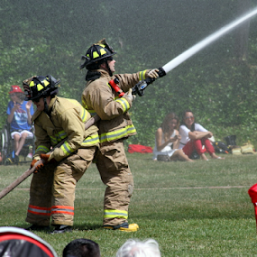 Fire Hose Tug of War by Bill Foreman - Public Holidays July 4th ( public park, teamwork, firemen, july 4th, firehose,  )