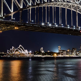 Sydney Harbour Bridge by Patric Rosberg - Buildings & Architecture Public & Historical ( reflection, skyline, street, ocean, architecture, beauty, road, people, business, city, modern, life, sky, skyscraper, midnight, transport, dark, buildings, central, sydney, water, office, structure, beautiful, sea, tourism, landmark, tower, corporate, traffic, outdoors, outdoor, scene, night, scenery, bridge )