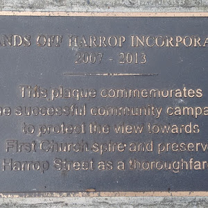 Transcript:Hands Off Harrop Incorporated2007 - 2013This plaque commemorates the successful community campaign to protect the view towards First Church spire and preserve Harrop Street as a ...