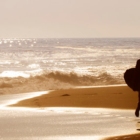 surfer walking beside shore by Cristobal Garciaferro Rubio - People Street & Candids ( shore, water, sand, pwcsilhouettemotion, surfer, waves, sea, walker )
