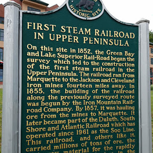 On this site in 1852, the Green Bay and Lake Superior Rail-Road began the survey which led to the construction of the first steam railroad in the Upper Peninsula. The railroad ran from Marquette to ...