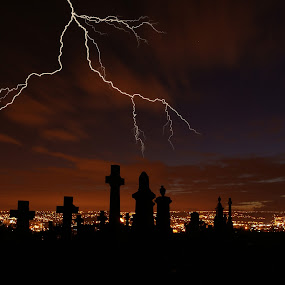Lightening Over Bradford City by Sandra Cockayne - City,  Street & Park  Skylines ( lightening bolts, lightening, night scene, cemetery, sandra cockayne, gravestones, city, graveyard,  )