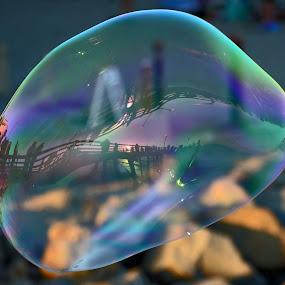 Oceanside Pier refelected in bubble by Peter Murnieks - Buildings & Architecture Bridges & Suspended Structures ( sand, bubble, sunset, pier, beach, rocks, pwcbridges, circle, pwc79, , reflection )