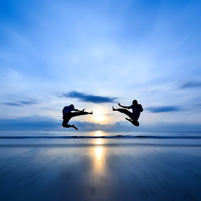 Flying Kick VS Flying Kick by Shahril Khmd - People Street & Candids ( flying, kick, sunset, ocean, sunrise, silhouette )