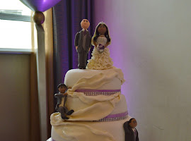5 tiered white and lilac wedding cake