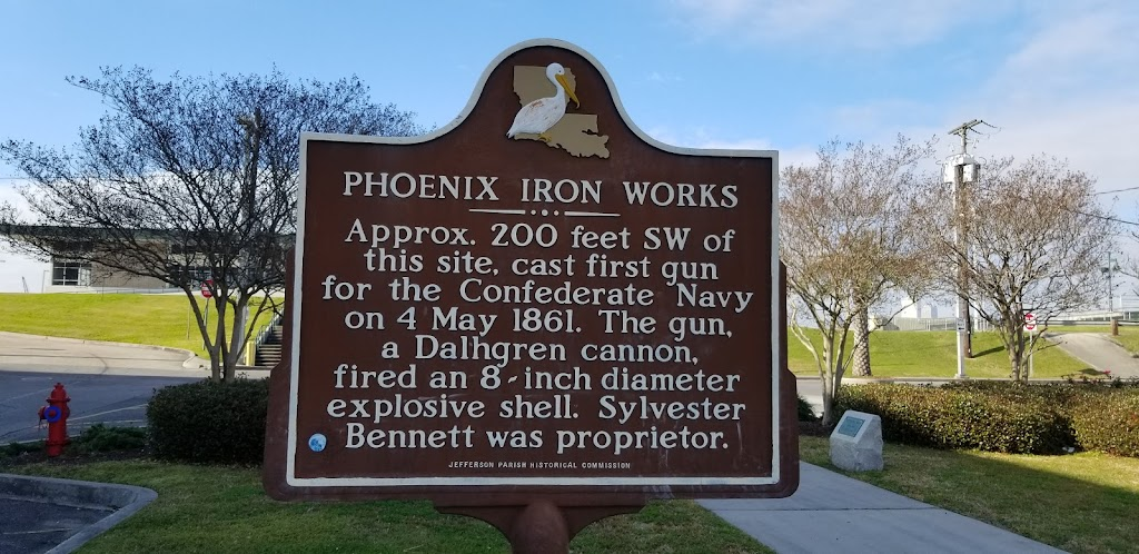 Approx. 200 feet SW of this site, cast first gun for the Confederate Navy on 4 May 1861. The gun, a Dalhgren cannon, fired an 8~inch diameter explosive shell. Sylvester Bennett was proprietor.
