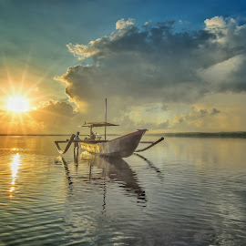 Sunrise /human interest  by Bobo Tandiono - Transportation Boats ( boat.clouds. people. sun.reflection. )