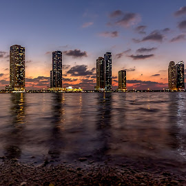 Sharjah Colorful Sunset by Wissam Chehade - City,  Street & Park  Skylines ( canon, clouds, cityscapes, water, skyline, colorful, seascapes, sea, architecture, travel, beach, waterscapes, city, sky, towers, sigma, sunset, uae, warmth, night, landscapes, light, sharjah,  )