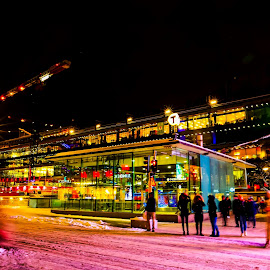 PINK SNOW by Michael Rey - City,  Street & Park  Night ( shopping center, winter, stockholm, city streets, snow, dark sky, pedestrians )