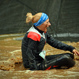 Crying In The Muddy Water by Marco Bertamé - Sports & Fitness Other Sports ( water, splatter, differdange, 2015, blond, crying, soup, luxembourg, muddy, red, sitting, blue, strong, woman, lady, brown, strongmanrun )
