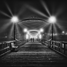 Walking Towards The Light - B&W by Garry Dosa - Black & White Street & Candid ( abstract, lights, december, b&w, black and white, silhouette, pier, night, people, darkness, evening, etheral )