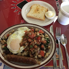 Hominy, black beans, red onion and tomatoes topped with an egg and salsa. 