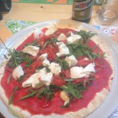 Gf pizza with mozzarella, cherry tomatoes, and arugula