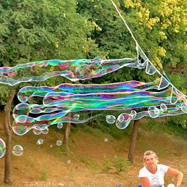 Bubbles by Radu Eftimie - City,  Street & Park  Street Scenes ( soap bubbles )