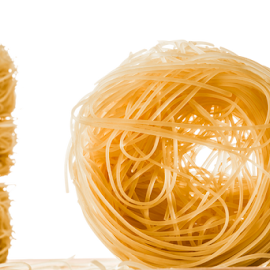 A roll of Angels Hair Spaghetti. by Jacques Jacobsz - Food & Drink Ingredients ( other, italian, recipe, one, made, cultural, refined, strings, another, balls, spaghetti, three, cooking, fine, hair, top, wheat, isolated, stacked, leaning, dry, on-top, angel's, wheels, milled, white, pasta, boil, starch, many, soften, angel, tower, flour, semolina, food, background, grain, thin, staple, each, durum, culture )