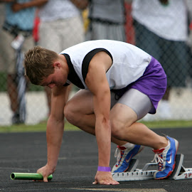 In the blocks by Keith Johnston - Sports & Fitness Running ( track and field, track, blocks, runner, running, athlete )