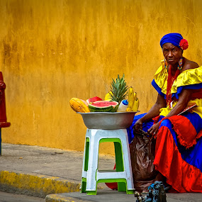 Bored Palenquera, Cartagena, Colombia by Stephanie Walsh - People Street & Candids ( colombia, fruit, woman portrait, colourful, cartagena, street vendor, colorful, woman, candid street photography, fruit seller, palenqueros, palenquera )
