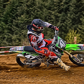 by Marco Bertamé - Sports & Fitness Motorsports ( curve, forty-seven, green, 47, number, race, red, motocross, dust, clumps, alone, accelerating, competition )