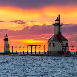 St. Joseph Sunset by Kenneth Keifer - Buildings & Architecture Public & Historical ( port, harbor, colorful, vivid, shining, vibrant, north pier, landscape, breathtaking, attraction, historic, st. joseph, sky, nature, dramatic, pier, range lights, light, skyscape, sightseeing, clouds, majestic, beautiful, lighthouse, lake, scenic, seascape, great lakes, dusk, michigan, two, lake michigan, catwalk, sunset, sundown, beacon )