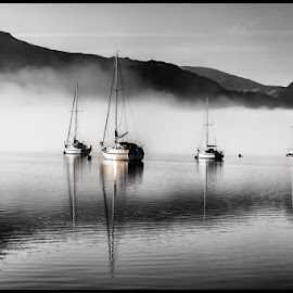 Derwent Lake by Ben Rob - Transportation Boats ( black and white, boats, reflections, derwent lake, lake district buttermere, relax, tranquil, relaxing, tranquility,  )