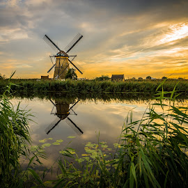 by Kevin Warrilow - Buildings & Architecture Public & Historical ( water, lillies, canals, sunset, kinderdijk, holland, reflections, windmills )