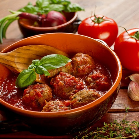 Meatballs With Cheese In Tomato Sauce