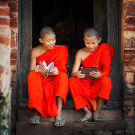 Two Buddhist novice are learning a knowlegd in temple . by Visoot Uthairam - Babies & Children Children Candids ( face, laos, monk, tantric, thailand, children, thai, study, tibet, education, rustic, people, asian, religion, nepalese, buddhism, student, happy, indonesia, tradition, lifestyle, asia, indigenous, cambodia, nepal, lesson, novice, national, tibetan, poor, traditional, vietnam, malaysia, learning, kids, young, luang, rural, classroom, myanmar, nationality, school, prabang, monastery, book, local, boy, religious, culture )