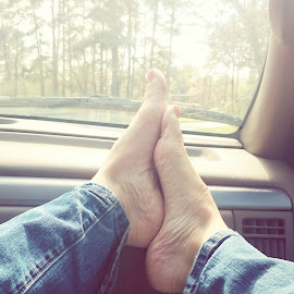 Feet up  by Marie Mcdaniel - People Body Parts ( girl, window, road trip, woman, feet, transportation )