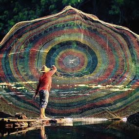 The Net Caster (2) by Lucky E. Santoso - People Fine Art