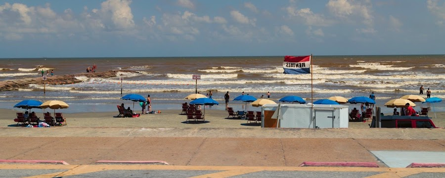 Fun at the Beach by Bonnie Davidson - Public Holidays July 4th ( clouds, water, sand, white, ocean, yellow, beach, landscape, people, city, holiday, galveston island, sky, umbrellas, nature, blue, beige, gulf of mexico,  )