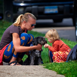 The love of a child by Mike Woodard - People Street & Candids ( little girl, girl, puppy, dog, paws on grand )
