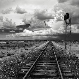 Desert Exploration  by Barbara McCourt - Black & White Landscapes ( clouds, mountains, train track, desert southwest, desert landscape, new mexico )