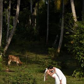 Kiss in the forest by Andrew Morgan - Wedding Bride & Groom ( love, kiss, zanzibar, wedding, forest, bride, groom )