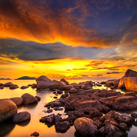 Rock beach on sunset by Dany Fachry - Landscapes Beaches