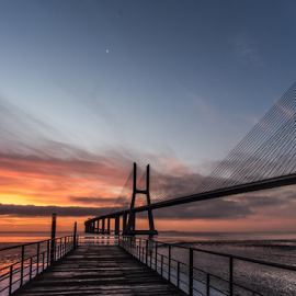 Sunrise by Alexandre Mestre - Buildings & Architecture Bridges & Suspended Structures ( cloud, orange, cloudy, sunrise, lisbon, deck, sunset, bridge, river, water )