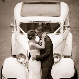 Wet Wedding by Brad N Sky Thomson - Wedding Bride & Groom ( #kiss, #love, #bride, #car, #wedding, #water, #groom, #rain )