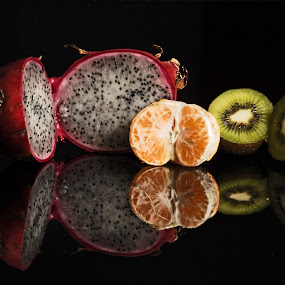 Exotic fruits and orange by Cristobal Garciaferro Rubio - Food & Drink Fruits & Vegetables ( kiwy, exotic fruits, reflectioon, fruits, pitahaya )
