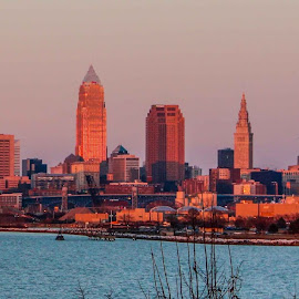 Cleveland by Bradford Fenton - City,  Street & Park  Skylines ( clear, water, reflection, skyline, building, blue, sunset, edgewater beach in cleveland, city )