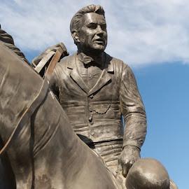 Doc by Eva Ryan - Buildings & Architecture Statues & Monuments ( cowboy, statue, sky, oklahoma, horse, closeup, hat )