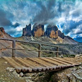 Bridge to Tre Cime by Steve Rogers - Landscapes Mountains & Hills ( clouds, trail, avalon-art, cloudscape, wood bridge, storms, dolomites, bridge, trails, storm, peaks, tre cime )