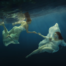 Angels by Dmitry Laudin - People Fashion ( body, person, underwater, joy, beauty, recreation, people, swimming, together, girl, pool, happy, woman, teenager, lifestyle, swim, couple, hair, activity, water, beautiful, white, under, romantic, dive, leisure, fun, young, holiday, two, vacation, female, blue, dress, summer, active, dance )