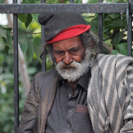 fighting with his own sorrow & sadness. by Lovnit Singh - People Portraits of Men ( santa sorrow sadness road click street walk )
