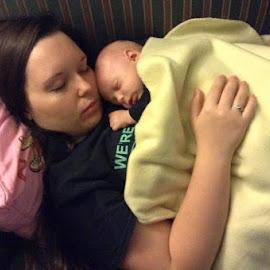 Children cuddle  by Daniel Paden - People Family ( warm, teen, baby, sleep, cuddle,  )