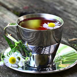 by Dipali S - Food & Drink Alcohol & Drinks ( cup, beverage, saucer, drink, daisy, herbal, steel, tea, flower )