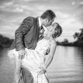 The Kiss by John Filmalter - Wedding Bride & Groom ( kiss, black and white, wedding, couple, scenery, bokeh )