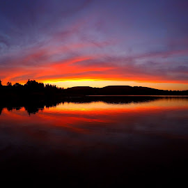 Romantic sunset on a lake by Nicki Aufrichtig - Landscapes Waterscapes ( nickiaufrichtig, clouds, hills, waterscape, wallpaper, beautiful, water mirrors, romantic, horizon, lake, beach, relaxation, landscape, romance, dusk, sun, afterglow, love, mountains, sky, red, sunset, summer, evening )