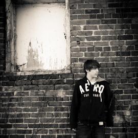 In the Alley by Myra Brizendine Wilson - People Portraits of Men ( sepia, window, brick wall, brick building, man,  )